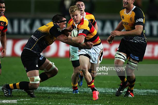 Damian McKenzie of Waikato makes a break during the round three ITM Cup match between Waikato and Taranaki at Waikato Stadium on August 27 2014 in...