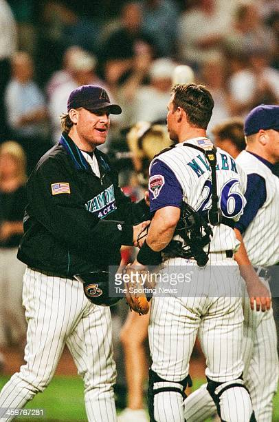 Damian Miller and Curt Schilling of the Arizona Diamondbacks shake hands following Game One of the World Series against the New York Yankees on...
