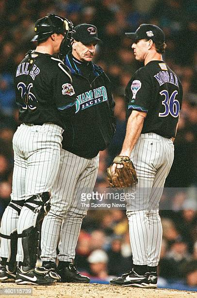 Damian Miller Bob Brenly and Mike Morgan of the Arizona Diamondbacks talk during Game Three of the World Series against the New York Yankees on...