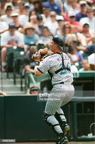 Damian Miller of the Arizona Diamondbacks fields against the Colorado Rockies at Coors Field on May 22 1999 in Denver Colorado