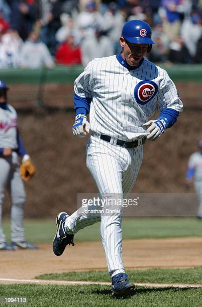 Damian Miller of the Chicago Cubs trots toward home after hitting a 2run home run in the second inning of the game against the Montreal Expos at...