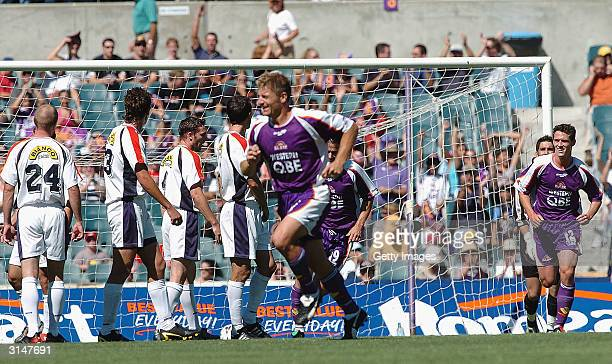 Damian Mori of Perth Glory scores a goal during the NSL Finals match between Perth Glory and Adelaide United at Subiaco Oval March 28 2004 in Perth...