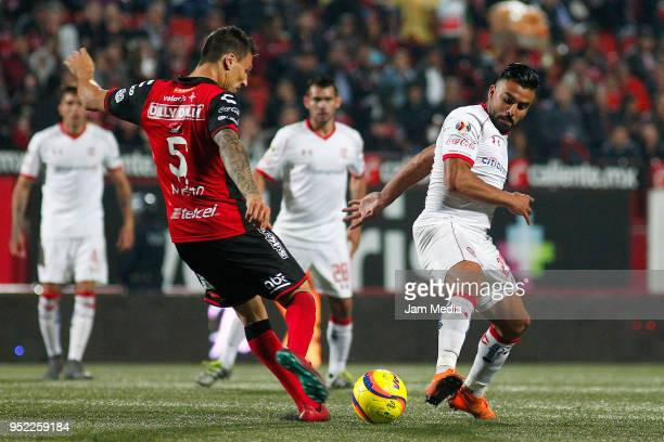 Damian Musto of Tijuana and Pedro Canelo of Toluca fight for the ball during the 17th round match between Tijuana and Toluca as part of the Torneo...
