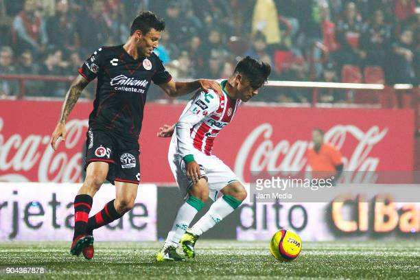 Damian Musto of Tijuana and Xavier Baez of Necaxa fightsfor the ball during the second round match between Tijuana and Necaxa as part of Torneo...