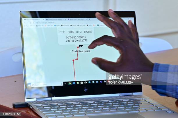Damian Otieno an IT engineer demonstrates on his computer how technology is applied to animal tracking at OlPejeta conservancy at Laikipia's county...