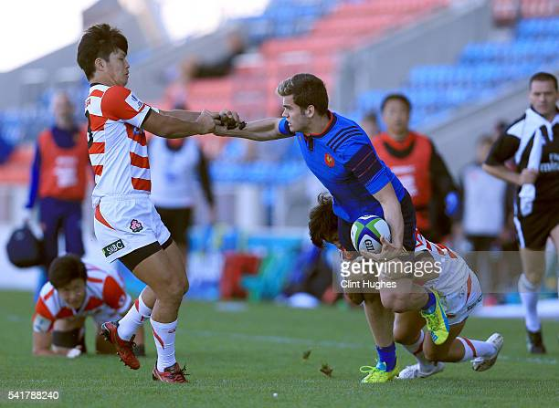 Damian Penaud of France is tackled by Takuhei Yasuda and Shintaro Nagatomi of Japan during the World Rugby U20 Championship 9th Place Semi Final...
