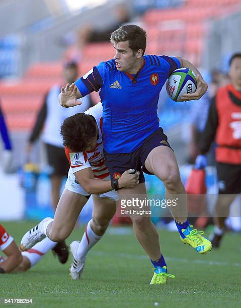 Damian Penaud of France is tackled by Takuhei Yasuda of Japan during the World Rugby U20 Championship 9th Place Semi Final match at the AJ Bell...