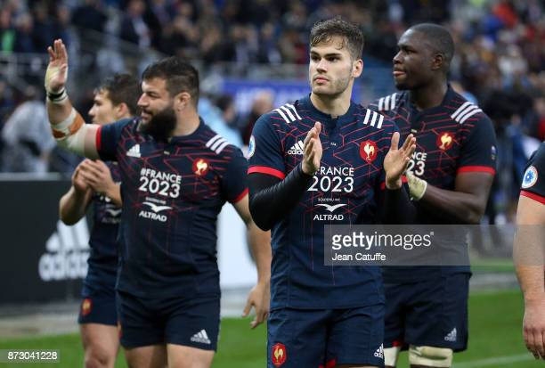 Damian Penaud of France, Rabah Slimani , Judicael Cancoriet salute the fans during the autumn international rugby match between France and New...
