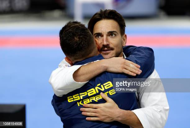 Damian Quintero of Spain seen celebrating with his coach after winning during the finals of the Men's Karate Kata competition of the 24nd Karate...