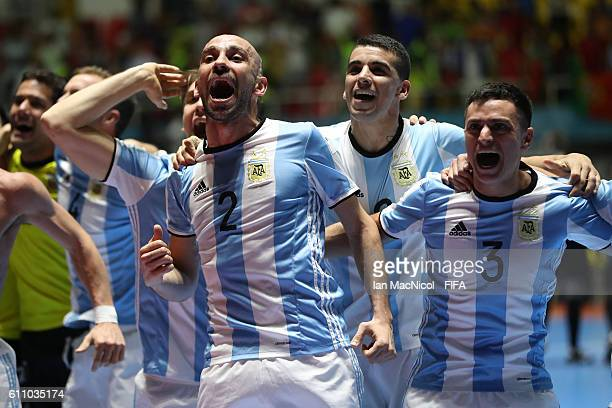 Damian Sarmiento of Argentina celebrates with team mates at the final whistle during the FIFA Futsal World Cup Semi Final match between Argentina and...