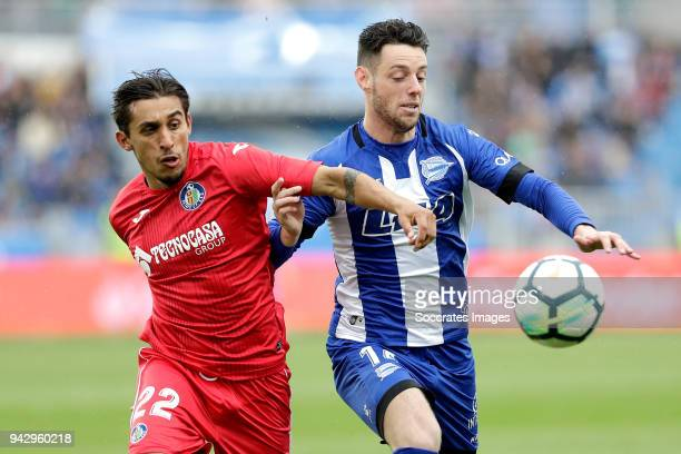 Damian Suarez of Getafe Burgui of Deportivo Alaves during the La Liga Santander match between Deportivo Alaves v Getafe at the Estadio de...