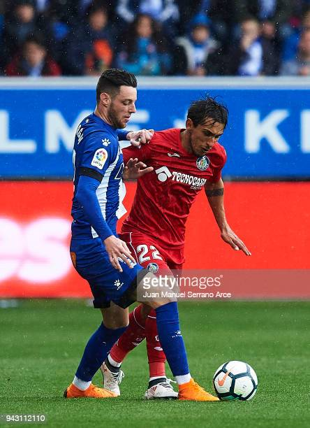 Damian Suarez of Getafe CF duels for the ball with Jorge Franco 'Burgui' of Deportivo Alaves during the La Liga match between Deportivo Alaves and...