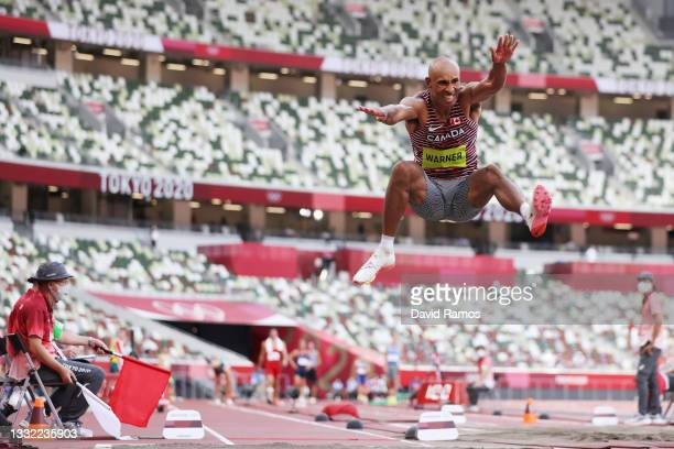 Damian Warner of Team Canada competes in the Men's Decathlon Long Jump on day twelve of the Tokyo 2020 Olympic Games at Olympic Stadium on August 04,...