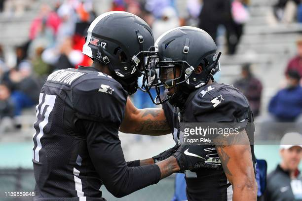 Damian Washington and Quinton Patton share a laugh after a play against the Atlanta Legends during the second half of the Alliance of American...