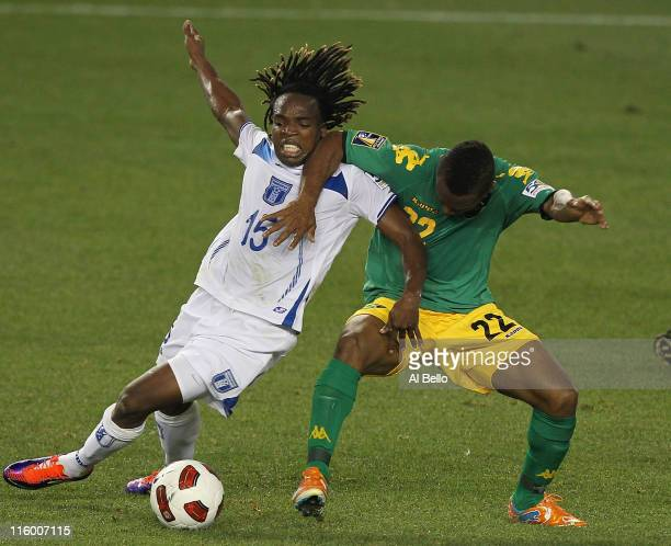 Damian Williams of Jamaica and Walter Martinez of Honduras battle for the ball during the Concaf Gold Cup at Red Bull Arena on June 13 2011 in...