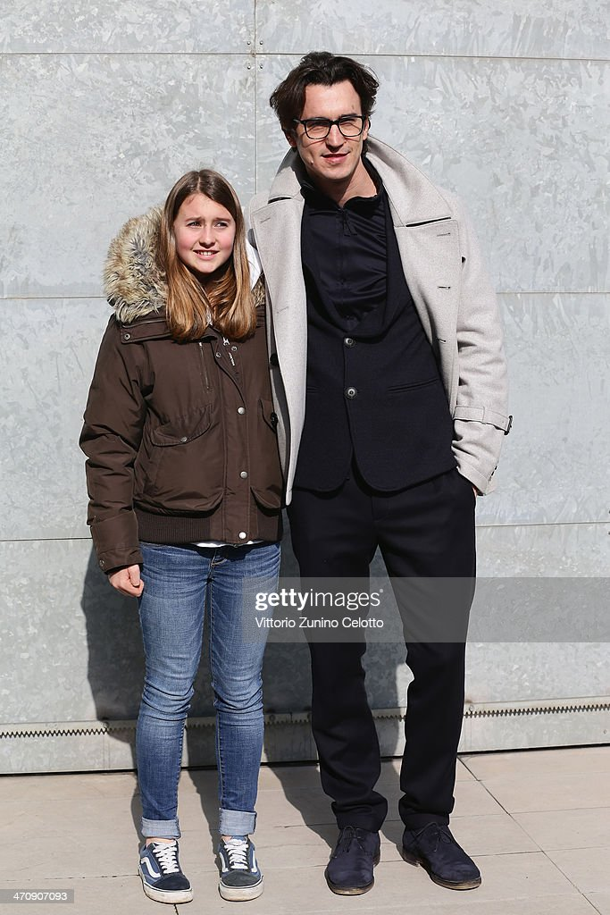 Damiano Michieletto and guest attend the Emporio Armani show as part of Milan Fashion Week Womenswear Autumn/Winter 2014 on February 21, 2014 in Milan, Italy.