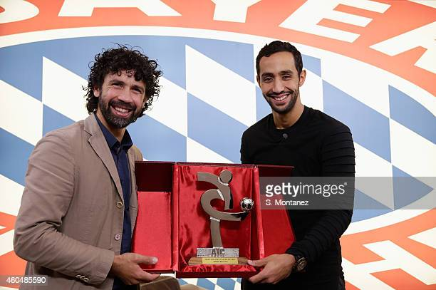 Damiano Tommasi president of the Italian Footballers' Association honours Mehdi Benatia of Bayern Muenchen as member of Serie Ateam of the year 2014...