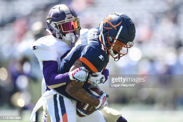 DamianSwann of the Atlanta Legends attempts to tackle JalinMarshall of the Orlando Apollos during the first half in an Alliance of American...