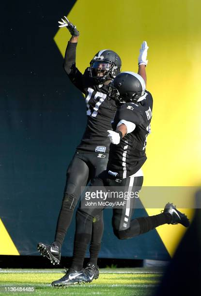 DamianWashington of the Birmingham Iron celebrates with teammates in the end zone after scoring an 83yard touchdown during the second quarter...