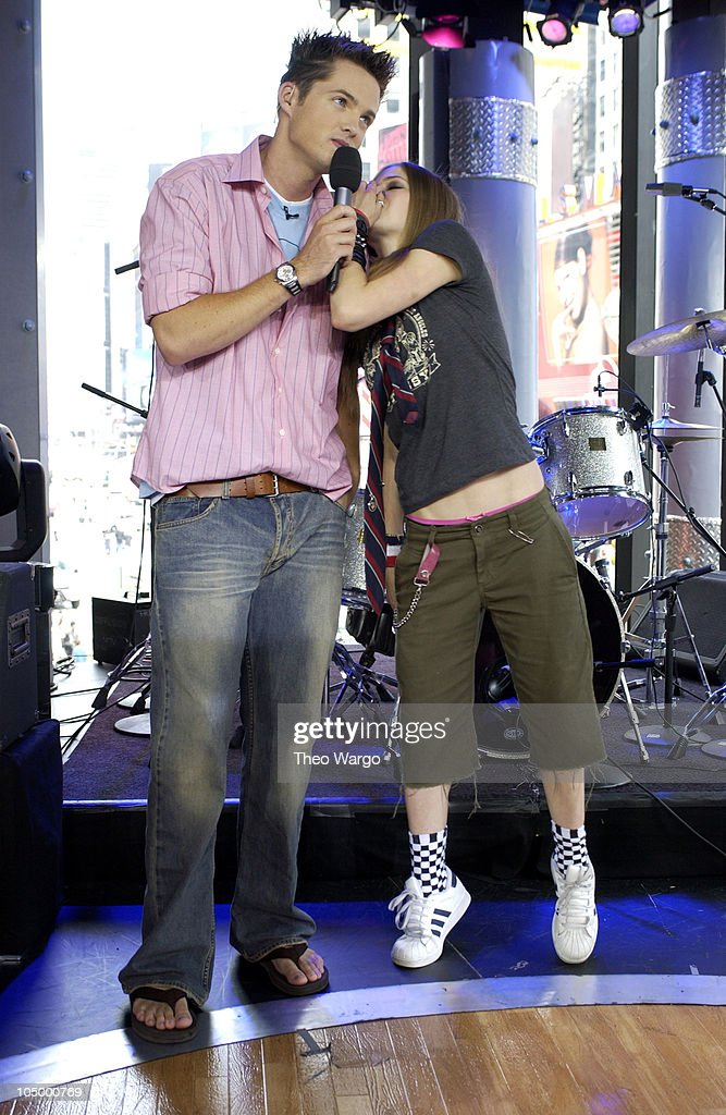 Damien and Avril Lavigne during Avril Lavigne Visits MTV's 'TRL' - August 22, 2002 at MTV Studios - Times Square in New York City, New York, United States.