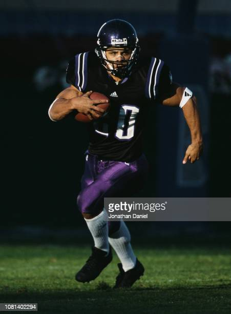 Damien Anderson Running Back for the Northwestern University Wildcats runs the ball during the NCAA Big Ten Conference college football game against...