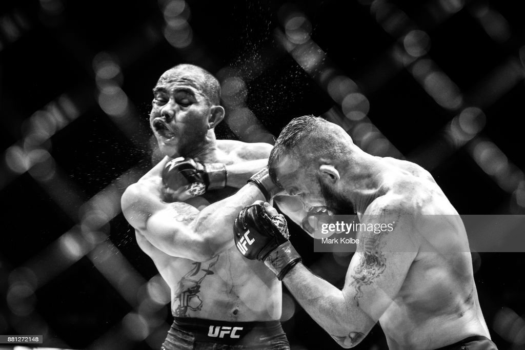 Damien Brown of Australia punches Frank Camacho of Guam in their lightweight bout bout during the UFC Fight Night at Qudos Bank Arena on November 19, 2017 in Sydney, Australia.
