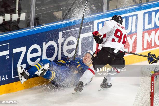 Damien Brunner clashes with John Klingberg during the Ice Hockey World Championship Quarterfinal between Switzerland and Sweden at AccorHotels Arena...
