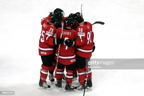 Damien Brunner of Switzerland celebrates his team's first goal with team mates during the IIHF World Championship group B match between Switzerland...