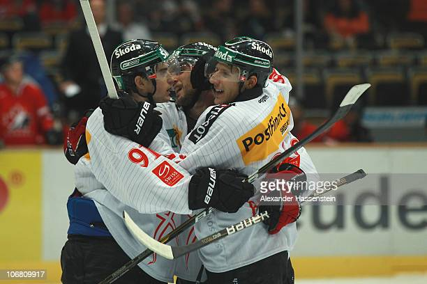 Damien Brunner of Switzerland celebrates scoring the opening goal his team mates during the German Ice Hockey Cup 2010 second round game between...