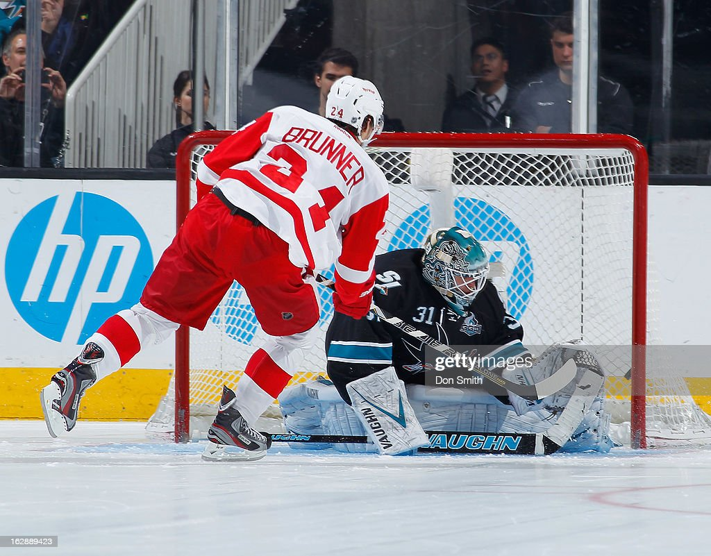 Damien Brunner #24 of the Detroit Red Wing scores the game-winning shoot-out goal against Antti Niemi of the San Jose Sharks during an NHL game on February 28, 2013 at HP Pavilion in San Jose, California.