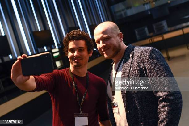Damien Chazelle and Dmitry attend Starmus V A Giant Leap sponsored by Kaspersky at Samsung Hall on June 26 2019 in Zurich Switzerland