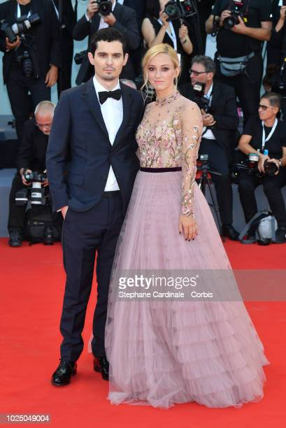 Damien Chazelle and Olivia Hamilton walk the red carpet ahead of the opening ceremony and the 'First Man' screening during the 75th Venice Film...