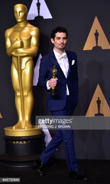 Damien Chazelle poses in the press room with the Oscar for Best Director during the 89th Annual Academy Awards on February 26 in Hollywood California...