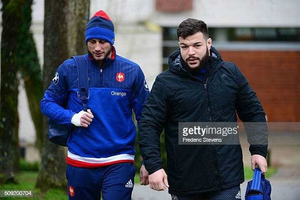 Damien Chouly and Maxime Medard of France arrive for a training session at National Center of Rugby in Marcoussis on February 9 2016 in Paris France...