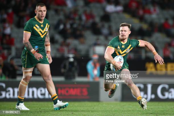 Damien Cook of Australia makes a break during the Rugby League International Test match between the Australia Kangaroos and Tonga at Eden Park on...