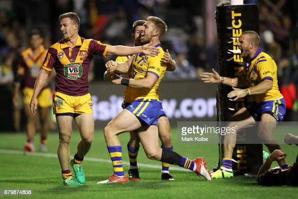 Damien Cook of Country looks dejected as Chad Townsend Bryce Cartwright and Nathan Ross of City celebrate a late try to Bryce Cartwright which...