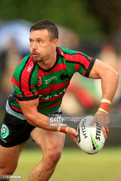 Damien Cook of Souths looks to pass during the NRL trial match between the South Sydney Rabbitohs and the Penrith Panthers at Redfern Oval on...