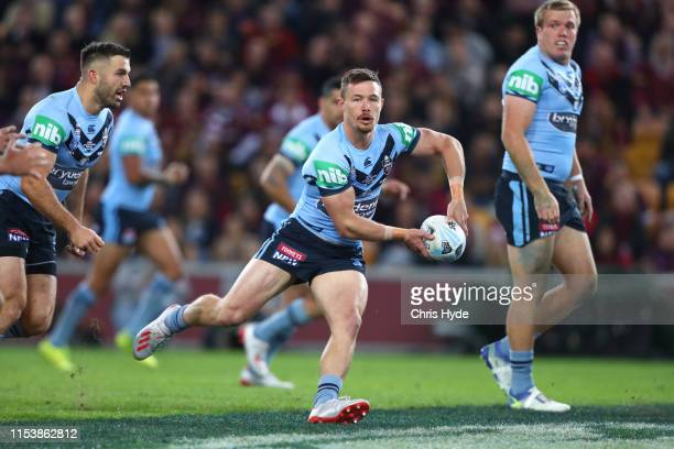 Damien Cook of the Blues passes during game one of the 2019 State of Origin series between the Queensland Maroons and the New South Wales Blues at...
