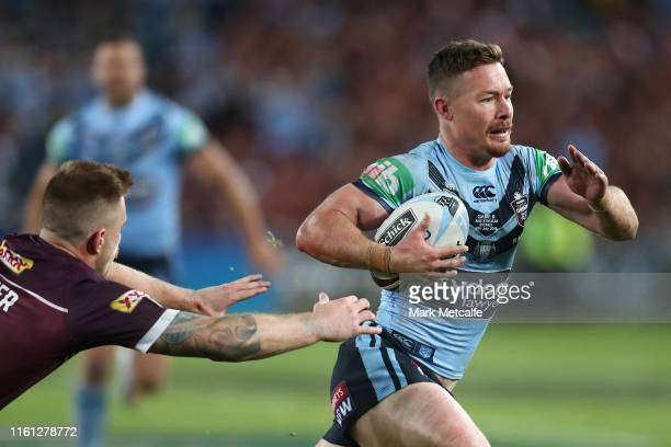 Damien Cook of the Blues runs in to score a try during game three of the 2019 State of Origin series between the New South Wales Blues and the...