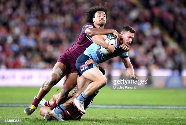 Damien Cook of the Blues takes on the defence during game one of the 2019 State of Origin series between the Queensland Maroons and the New South...