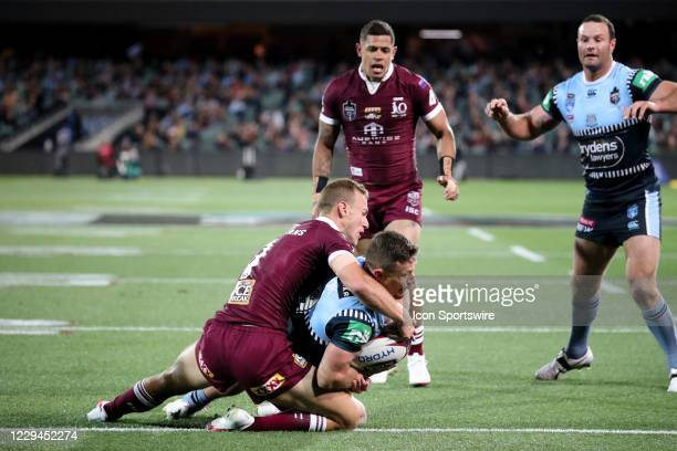 Damien Cook of the NSW Blues scores a try during game one of the 2020 State of Origin series between the Queensland Maroons and New South Wales Blues...