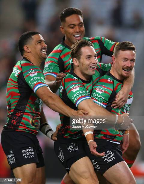 Damien Cook of the Rabbitohs celebrates after scoring a try during the round 12 NRL match between the South Sydney Rabbitohs and the Parramatta Eels...
