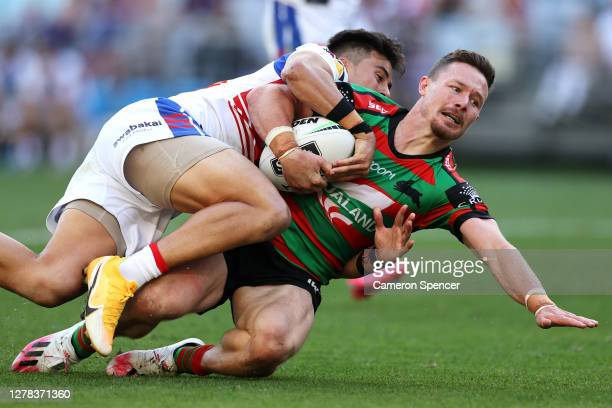 Damien Cook of the Rabbitohs heads in for a try during the NRL Elimination Final match between the South Sydney Rabbitohs and the Newcastle Knights...