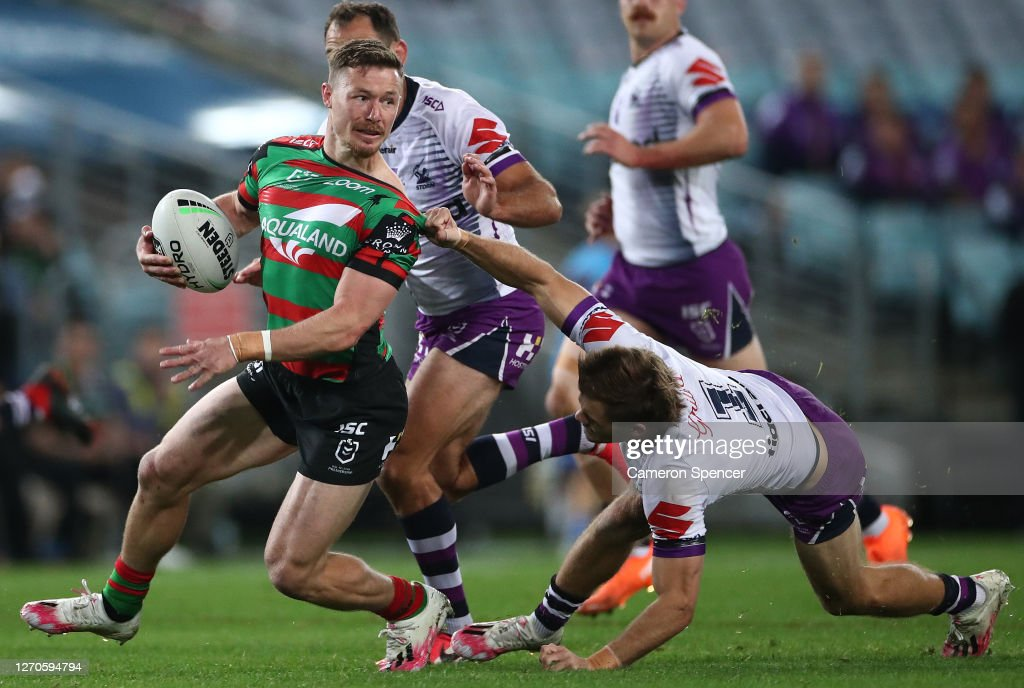 Damien Cook Of The Rabbitohs Is Challenged By Ryan Papenhuyzen Of The News Photo Getty Images