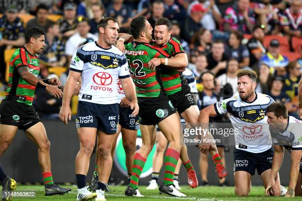 Damien Cook of the Rabbitohs is congratulated by team mate Sam Burgess after scoring a try during the round nine NRL match between the South Sydney...