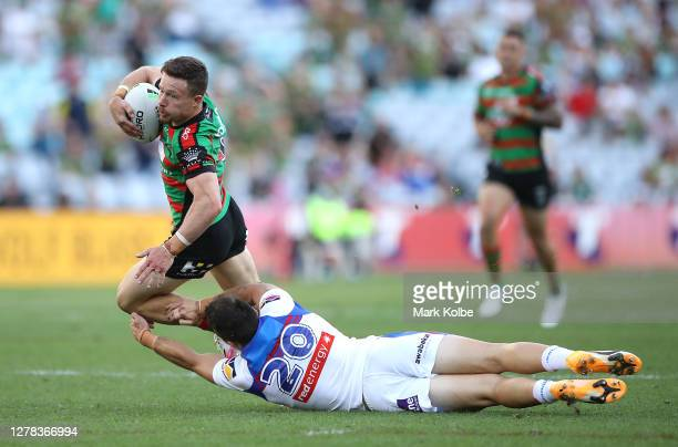 Damien Cook of the Rabbitohs is tackled by Tex Hoy of the Knights during the NRL Elimination Final match between the South Sydney Rabbitohs and the...