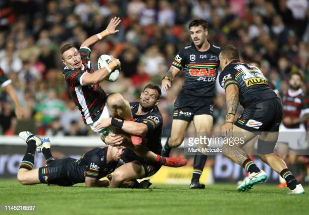 Damien Cook of the Rabbitohs Is tackled by Tim Grant of the Panthers during the round 7 NRL match between the Penrith Panthers and the South Sydney...