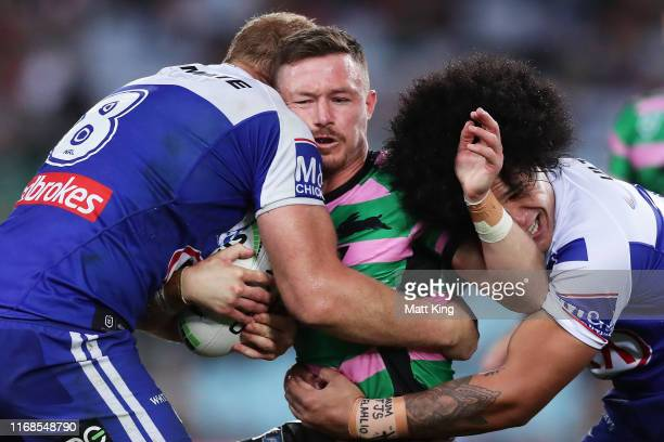 Damien Cook of the Rabbitohs is tackled during the round 22 NRL match between the South Sydney Rabbitohs and the Canterbury Bulldogs at ANZ Stadium...