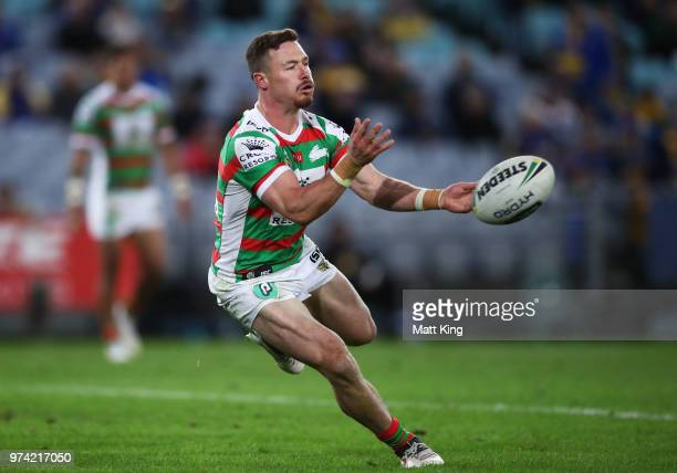 Damien Cook of the Rabbitohs passes during the round 15 NRL match between the Parramatta Eels and the South Sydney Rabbitohs at ANZ Stadium on June...
