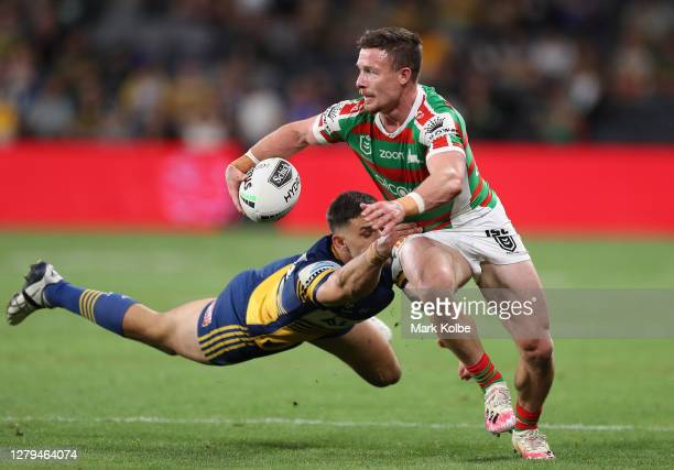 Damien Cook of the Rabbitohs runs with the ball during the NRL Semi Final match between the Parramatta Eels and the South Sydney Rabbitohs at...